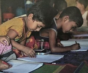 Rohingya refugee children learning in a safe educational area